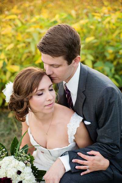 bride and groom in bean field