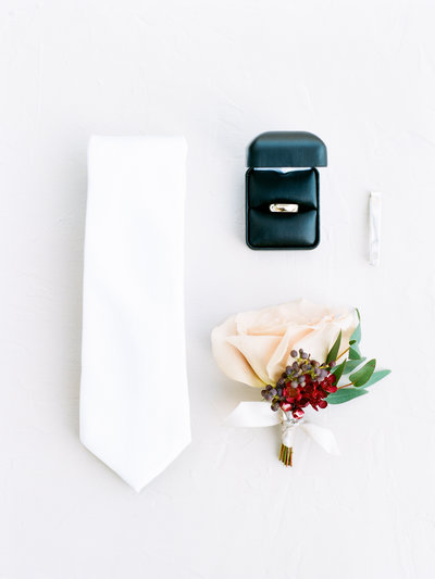 Heirloom groom details on his wedding day. The black ring box matches perfectly with the white rose bouquet.