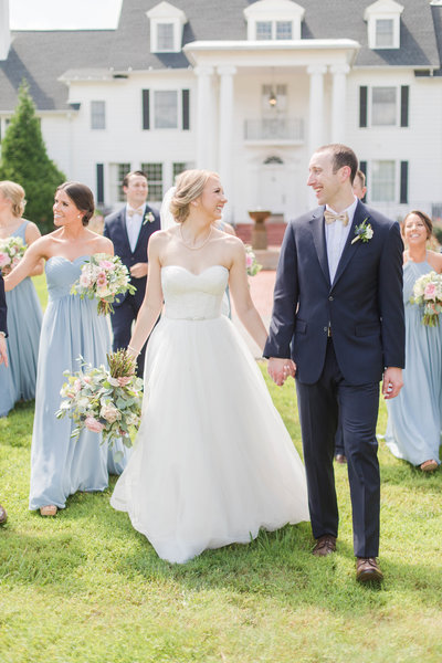 bride and groom with wedding party at kirkland manor with blue bridesmaids dresses