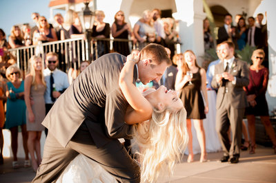 Groom-dips-bride-after-Kiss-at-Wedding-Ceremony-San-Clemente-Casa-Romantica