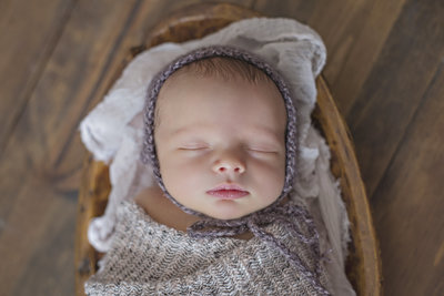 baby sleeping with bonnet
