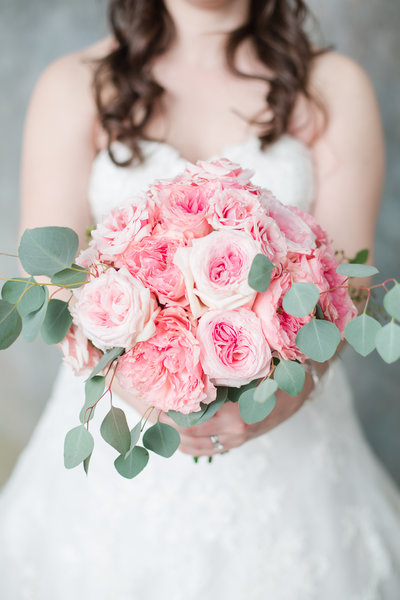 Bride holding a pink peony bouquet