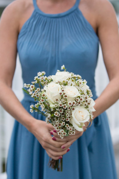 Bride in blue holding bridal bouquet