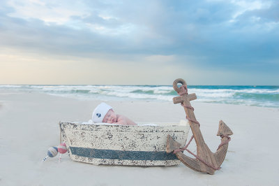 Baby in a boat at sunrise on Panama City Beach
