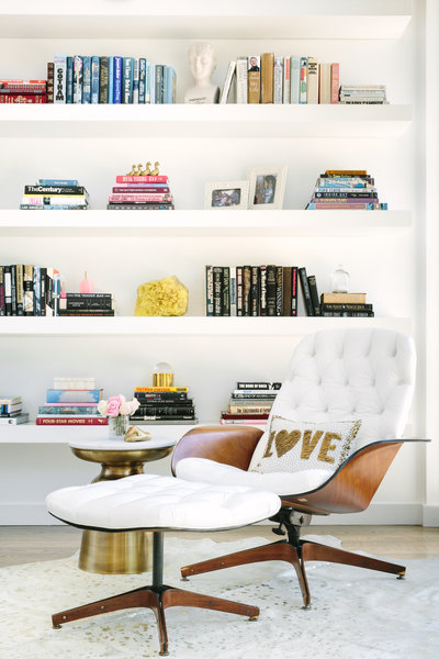 White Eames chair with Jonathan Adler pillow seating area | Los Angeles Interior Design