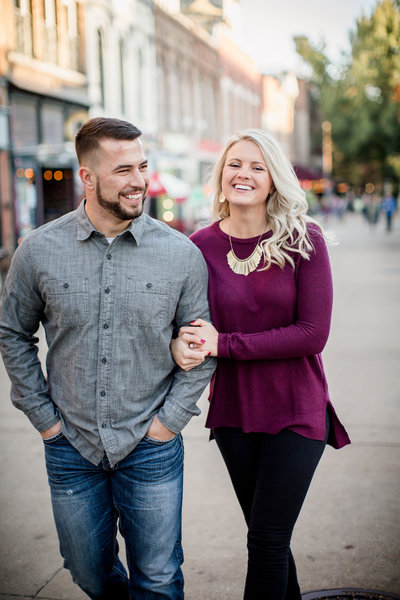 Walking in market square engagement photo by Knoxville Wedding Photographer, Amanda May Photos.