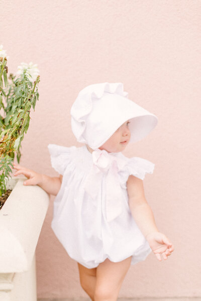little girl in charleston south carolina wearing a bonnet for family session by costola photography