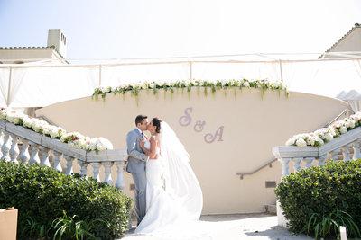 Bride and Groom kissing Marbella Country Club wedding in Orange County, CA San Juan Capistrano wedding photographer