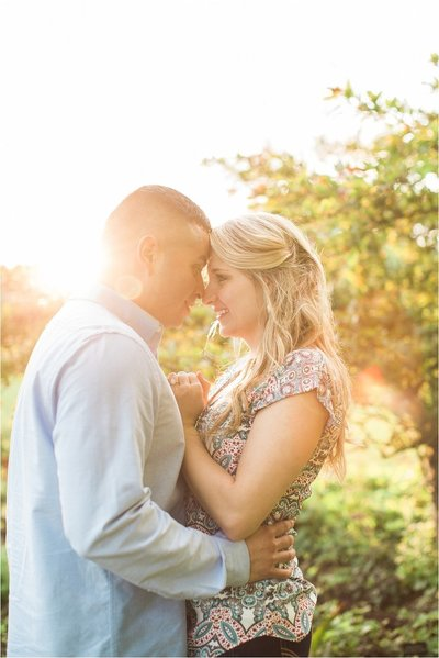 Wedding engagement photography | Man holding woman in sunny background