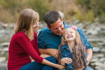 Colfax family session at the river laughing