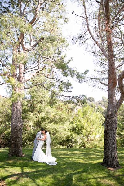 bride and groom kissing at Marbella Country Club wedding in Orange County, CA San Juan Capistrano wedding photographer