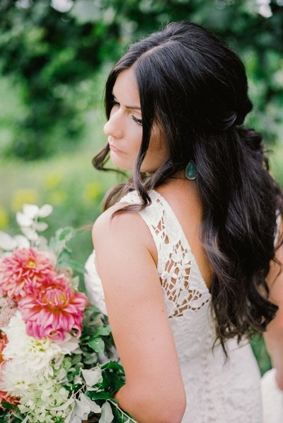 Wedding bridals photography | Bride holding flowers back view