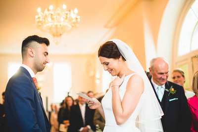 an emotional bride reads her own vows to the groom during a ceremony at iscoyd park