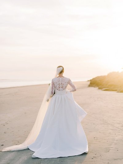 portrait of bride walking on beach