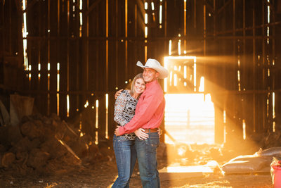 Lincoln CA engagement session couple in old barn at sunset