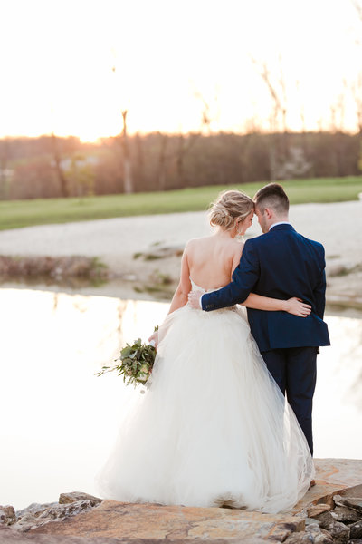 bride and groom overlooking pond at glen ellen farm in maryland