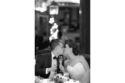 A couple kiss during their reception at Tivoli Terrace in Laguna Beach