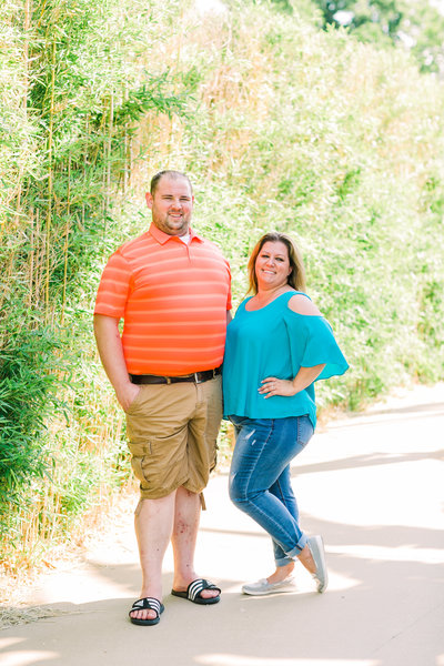 Hannah and Eric's engagement photo at the entrance of the St. Louis Zoo by Jackelynn Noel Photography