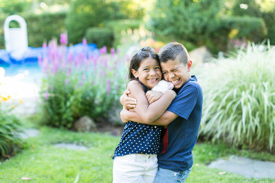 kids hugging  and smiling in the garden