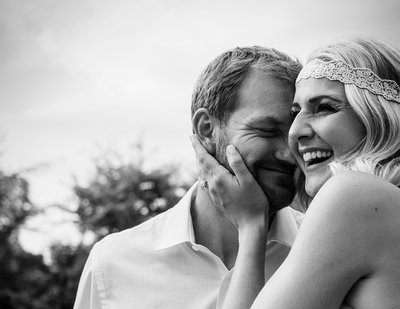 bride and groom smile and share a playful moment in Charlotte, NC