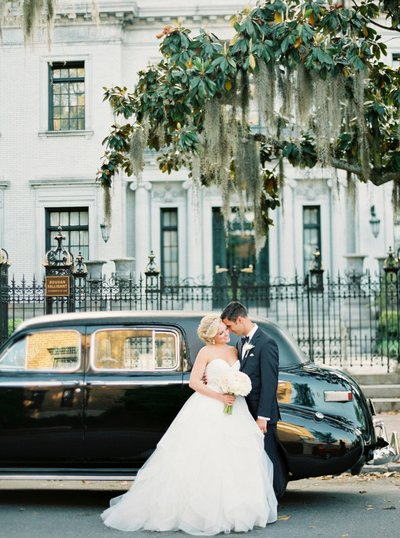 bride and groom with vintage car and spanish moss
