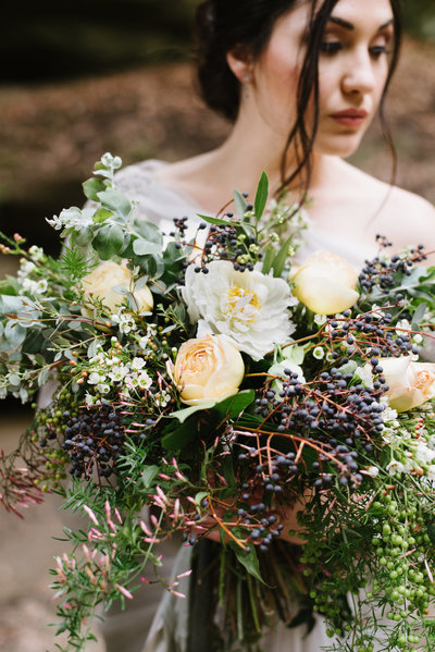Lovely bridal bouquet of muted neutrals and berry tones