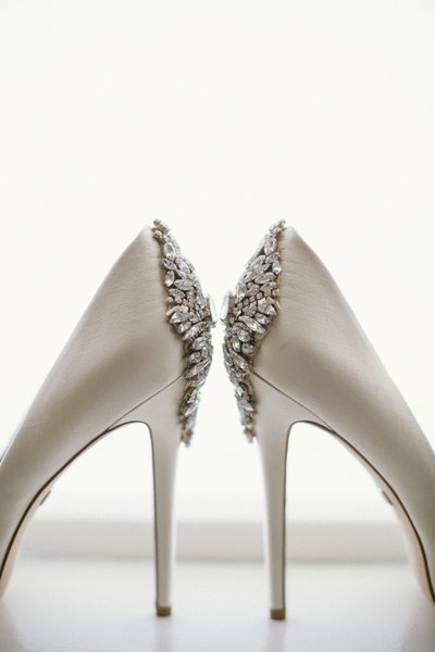 pair of badgley Mischkas heels on bed