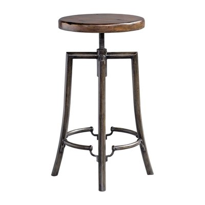 Swivel bar stool with wooden seat, metal legs, and antiqued finish from Hockman Interiors