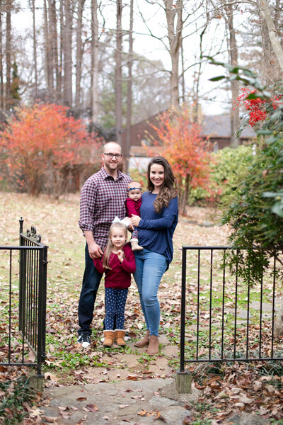 Kennesaw family stands close in beautiful fall folliage
