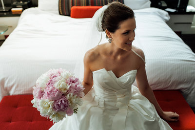 bride poses for portrait before wedding in philly