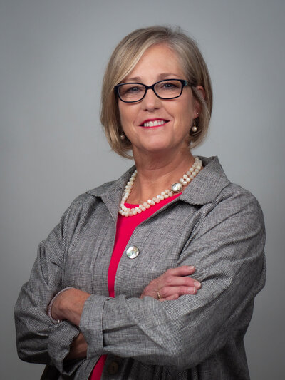 Corporate headshot makeup of female executive with glasses