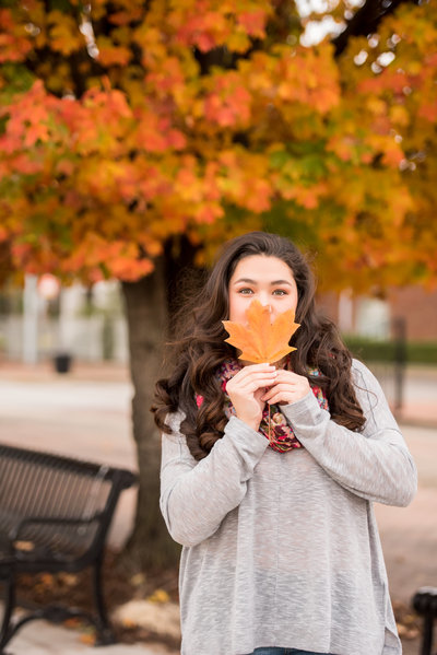 Alabama senior portrait photographer girl in fall leaves