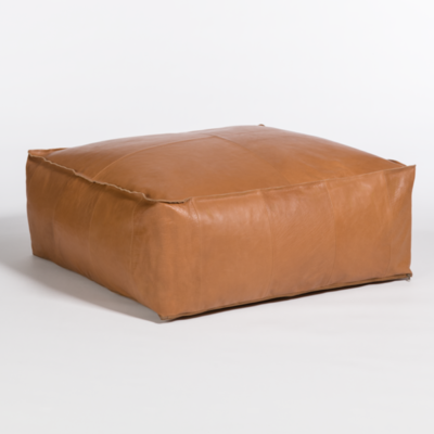 Tan, leather, square-shaped ottoman from Hockman Interiors