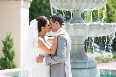 Bride and groom kissing at the fountain at Marbella Country Club wedding in Orange County, CA San Juan Capistrano wedding photographer