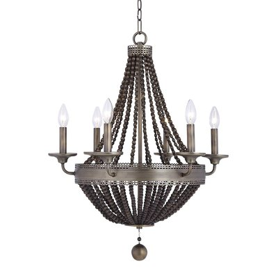Antiqued metal chandelier with circular beaded details and imitation candles from Hockman Interiors