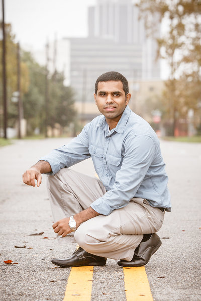 Natural light portrait of TJ Gangadharaiah in downtown Mobile, Alabama.