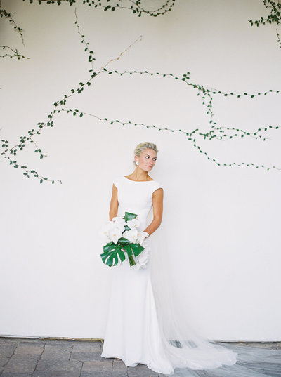 Bride holding flowers in all white