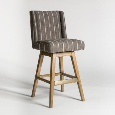 Striped dining stool with backrest and wood legs from Hockman Interiors