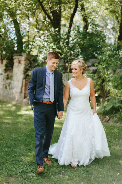 Bloom Lake Barn Minnesota boutique style Bride and groom holding hands