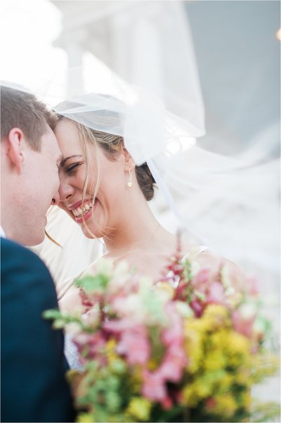 CB Photography package 3 | Bride forehead to forehead with groom. White veil flying in the wind