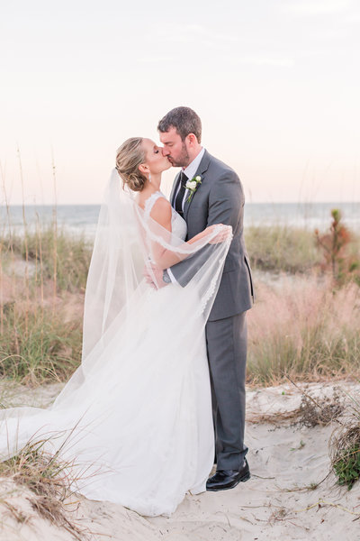 bride and groom portrait in the sand dunes at hilton head island