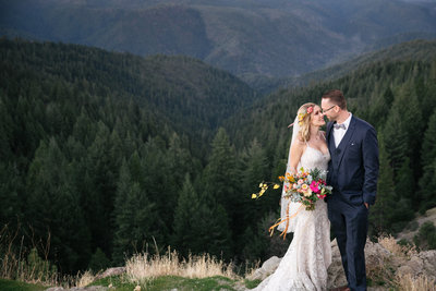 BoHo bride and groom overlooking forest