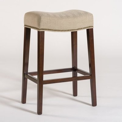 Tan dining stool without backrest from Hockman Interiors