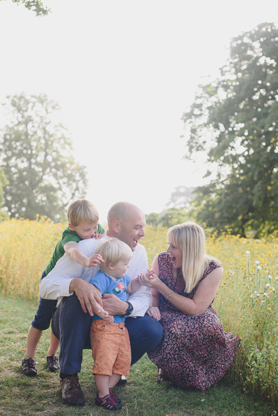 Family photo in wildflowers-Surrey-Susan Arnold Photography