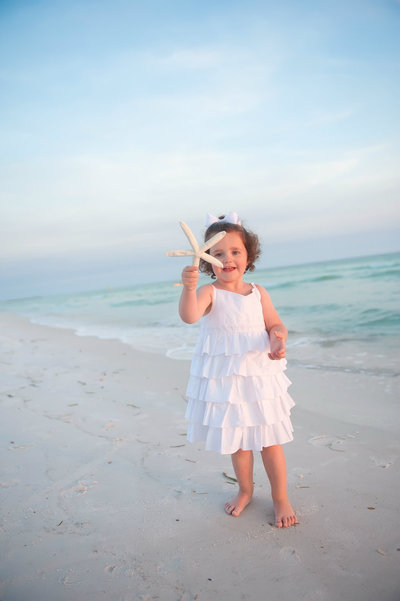 Little girl on Panama City Beach with a starfish