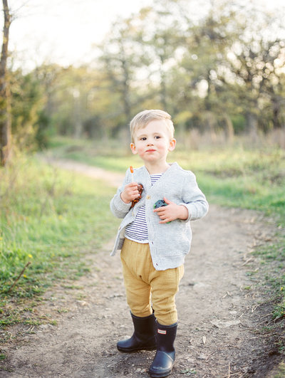 Little boy in Hunter Boots at Quarry Hill in Rochester, MN