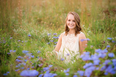 Alabama senior portrait photographer beautiful girl lying in grass pose