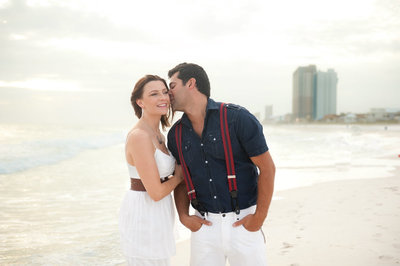 Husband kissing wife in Panama City Beach Florida