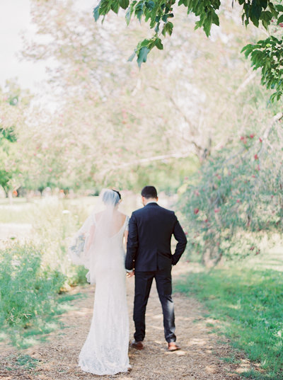 picture of bride and groom walking down a trail