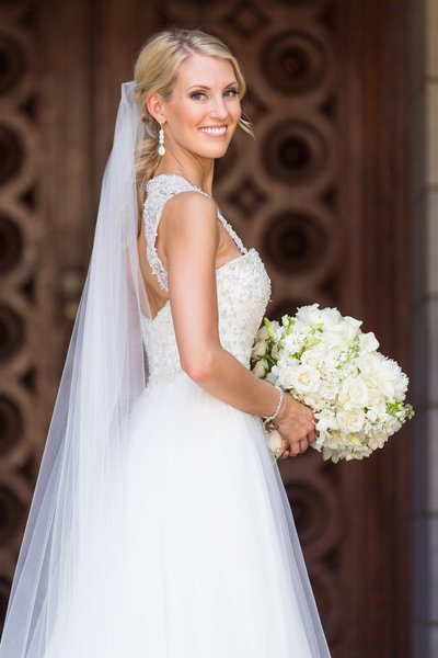 Bride portrait at St Louis venue, with ivory bouquet